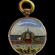 Reverse painted glass locket in shape of pocket watch - 1876 World's Fair souvenir