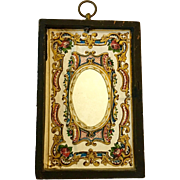 Antique mirror covered with embossed and printed papers