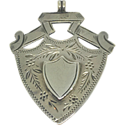 Antique sterling engraved watch fob, shield shape