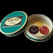 Box of embossed paper wafer seals, monogram B