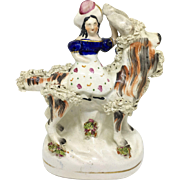 Staffordshire figure - girl riding a goat