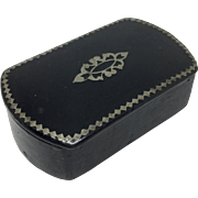 Ebonized papier mache snuff box with metal pique work