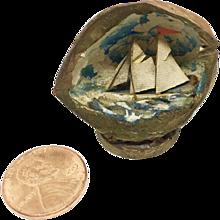 Miniature antique ship diorama in walnut shell