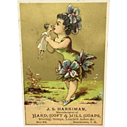 Antique trade card featuring girl with doll
