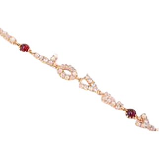A Love Bracelet in Ruby and Moonstone by Lucien Picard