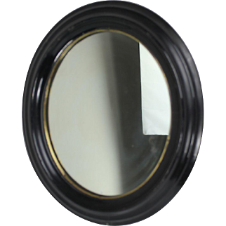 Ebonised oval mirror