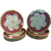 A Set of 12 Chamberlains Worcester Claret Ground Dinner Plates.