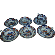 A Set of Seven Minton Amherst Japan Stone China Tea Cups and Saucers