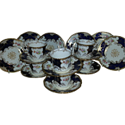 A Set of Six Coalport Blue Batwing Coffee Cups, Saucers and Plates
