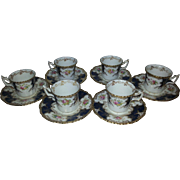Six Coalport Small Blue Batwing Coffee Cups and Saucers.