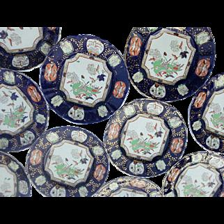 A Set of Twelve Mason's Ironstone Dinner Plates.