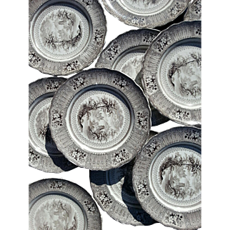 A Set of Twelve Staffordshire Brown Transfer Printed Plates in the Cologne pattern