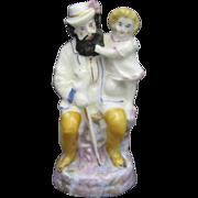 Miniature English Staffordshire Figure Group, Bearded Man and Child C.1880.