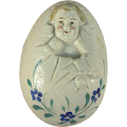 Baby in Egg Porcelain Figurine, Life Size Egg, C.1890.