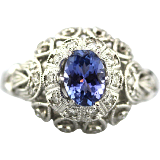 Regal Natural Tanzanite and Diamond Ring in 18KT White gold