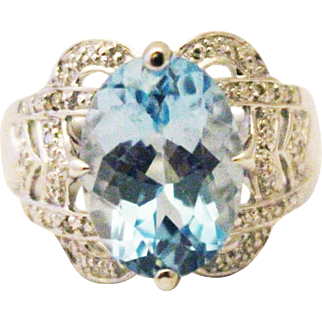 6 CT Natural Blue Topaz and Diamond Ring in 14KT White Gold