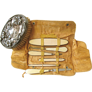 Victorian or Edwardian Celluloid Six Piece Traveling Manicure Set with Marked Empire ArtSilver Clothes Brush; Leather Cover and Silk Inner