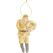Vintage Composition Santa Claus Dressed in Yellow Holding Wreath Christmas Ornament
