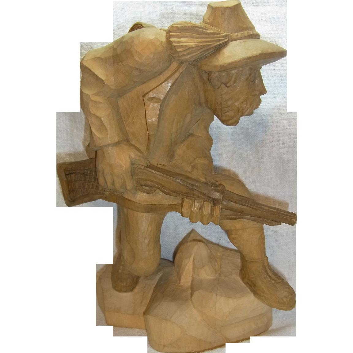 Vintage german black forest carved wood hunting man