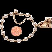 14 Karat Gold, Cultured Pearl, Piano Charm Bracelet