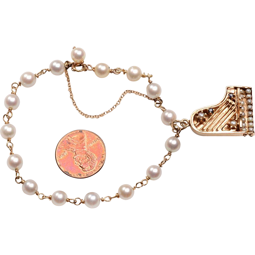 14 karat gold cultured pearl piano charm bracelet from