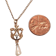 12kt (tested) Pendant with a diamond and pearls