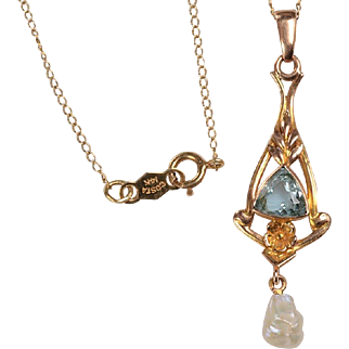 """Vintage 14kt Lavaliere with 18"""" Chain: set with a triangular, faceted blue topaz, and a Freshwater Pearl"""