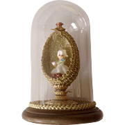 Napco Spaghetti Flower Girl Figurine in Hand Decorated Gold Easter Egg in Glass Dome with Wood Base
