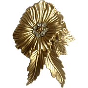 Vintage Flower Pin With Faux Diamond Center Lightweight Gold Tone Plastic Costume Jewelry