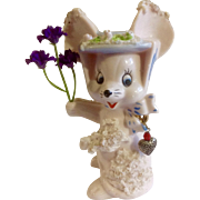 Vintage Pink Spaghetti Girl Mouse Ceramic Figurine Holding Purple Flowers