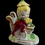 Vintage Norcrest Yellow Chrysanthemum November Month Pixie Elf Boy on Mum Flower Cart Ceramic Figurine F447