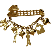 "Trifari Charm Brooch Bar With a Man, Woman Dog and House with Hearts, Costume Jewelry 1-3/4"" wide."