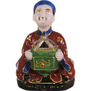 Porcelain Asian Man bearing gift Incense Burner with gold accents - Made in occupied Japan