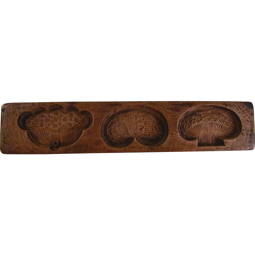 Antique deeply carved wood maple sugar mold floral and