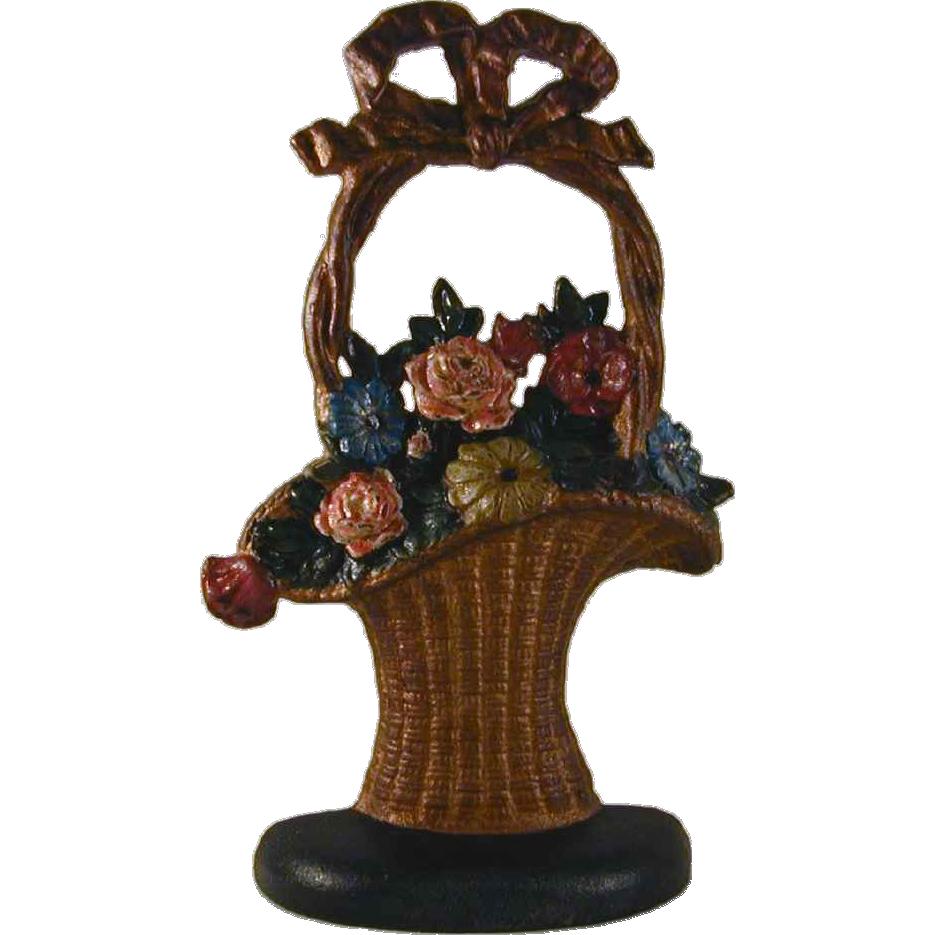 Vintage cast iron doorstop colorful flowers hubley 39 s french basket from giameraandc on ruby lane - Cast iron doorstop ...