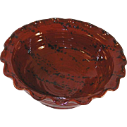 1989 Redware Deep Bowl Glazed Brown Colored with Dark Mottling Ruffled Edge and Ear Handle By Ned Foltz