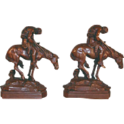 Vintage Heavy Bronzed Bookends Indian Warrior on His Horse Heads Bent Down with Bow in Hand