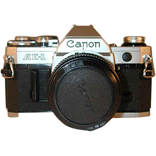 Nice 35 Millimeter SLR Camera Canon AE-1 With Canon Lens FD 28 mm 1:2.8