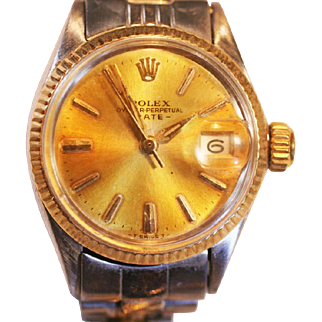Vintage Rolex Lady's watch Oyster Perpetual Date 14 k Gold Stainless steel.