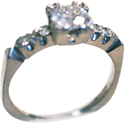 Vintage Platinum Diamond ring 0.65 carat central stone VS1 and 4 small stones o.o5 each on the sides 1930