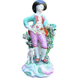 An Antique 18th c. Derby Porcelain Figurine of a young man with dog.