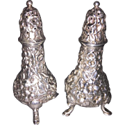 Pair Sterling Silver Footed Repousse Salt & Pepper Shakers
