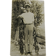 RPPC, 1909, fisherman with stringers of perch, New York.