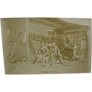 1910 Trapping, raccoon, muskrat, coon hounds, cabin - RPPC