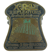 X-Ray reflectors advertising paperholder or paperclip ca.1915, office or library