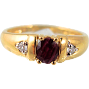 Vintage passion 18K stamped solid gold ring with faceted oval ruby enhanced by 2 small diamonds