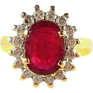 Elegant natural ruby set on 18K stamped solid gold and enhanced with 16 earth mined diamonds