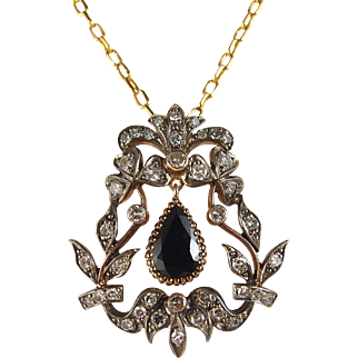 Early Victorian stamped solid rose gold and silver pendant, one pear faceted sapphire, 41 single cut diamonds, 3.03ctw
