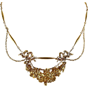 Remarkable antique French stamped 18K solid gold necklace, highly decorated center piece and featuring festoon cable chain