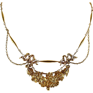 Remarkable antique French 18K solid gold necklace, highly decorated center piece and featuring festoon cable chain